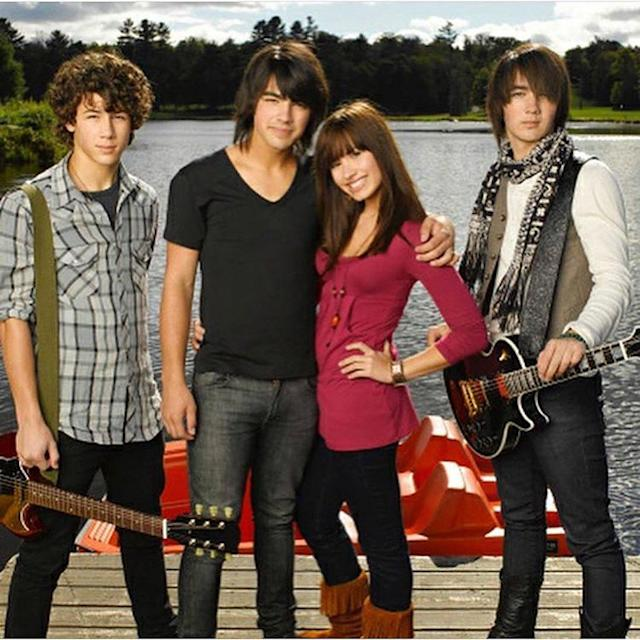 "<p>As the Disney movie <i>Camp Rock</i> marked their ninth anniversary, Jonas couldn't help but share a cheesy throwback. ""9 years of <a href=""https://www.instagram.com/p/BVklxvwgzL6/?taken-by=joejonas&hl=en"" rel=""nofollow noopener"" target=""_blank"" data-ylk=""slk:#Camprock"" class=""link rapid-noclick-resp"">#Camprock</a>,"" he wrote. ""I am starting to feel old! P.S. what's going on with these hair choices?"" LOL! (Photo: Joe Jonas via Instagram) </p>"