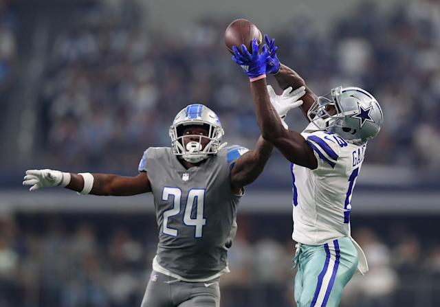 <p>Nevin Lawson #24 of the Detroit Lions tries to break up the pass caught by Michael Gallup #13 of the Dallas Cowboys in the first quarter of a game at AT&T Stadium on September 30, 2018 in Arlington, Texas. (Photo by Tom Pennington/Getty Images) </p>