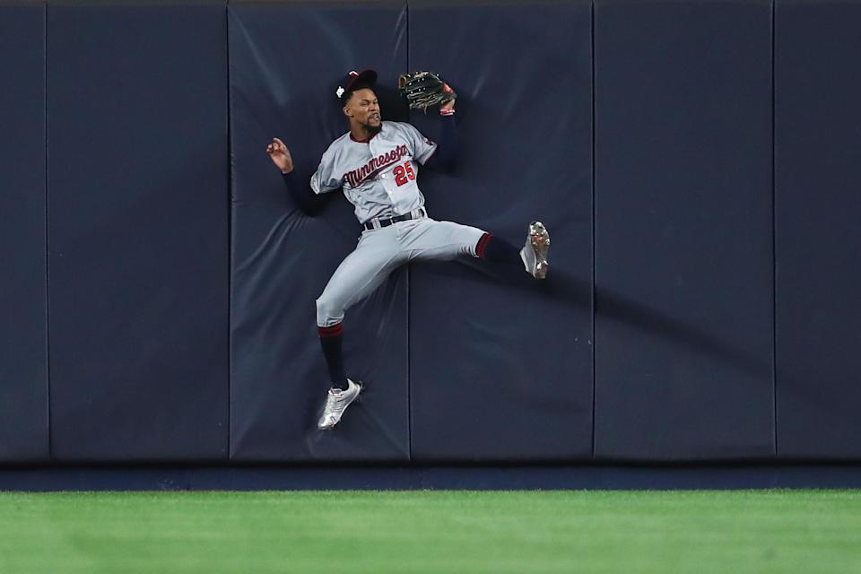 Byron Buxton crashed into the wall after an impressive catch in the AL wild-card game. (Getty Images)