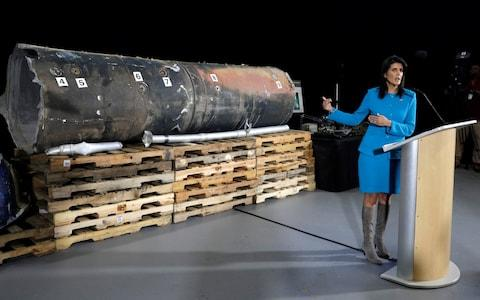 Nikki Haley briefs the media in front of remains of a ballistic missile  - Credit: REUTERS/Yuri Gripas