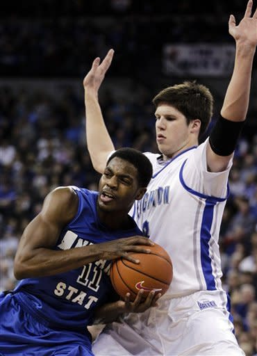 Indiana State's Devonte Brown, left, is defended by Creighton's Doug McDermott during the first half of an NCAA college basketball game in Omaha, Neb., Saturday, Jan. 5, 2013. (AP Photo/Nati Harnik)