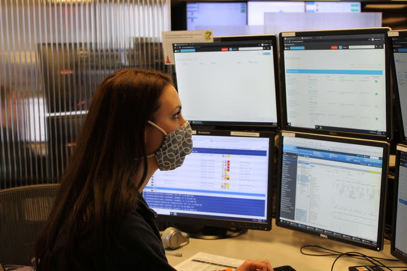 Emily Lardinois, a critical-care nurse, monitors intensive-care patients across the United States remotely from Advanced ICU Care's operations center in St. Louis