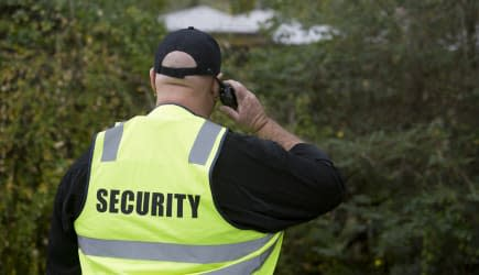 Overweight security guard with a walkie talkie