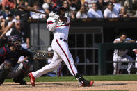 Chicago White Sox's Brian Goodwin, right, hits a walkoff home run during the ninth inning of a baseball game against the Cleveland Indians, Sunday, Aug. 1, 2021, in Chicago. (AP Photo/Matt Marton)