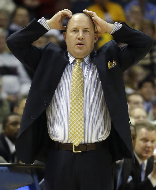 Marquette coach Buzz Williams reacts to a play during the second half of an NCAA college basketball game against Ball State on Tuesday, Dec. 17, 2013, in Milwaukee. (AP Photo/Morry Gash)