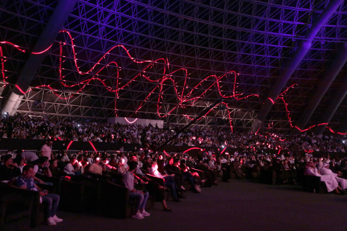 In this June 18, 2021 photo, an audience listens to Egyptian pop star Amr Diab during a concert, at the newly built Super Dome, in Jiddah, Saudi Arabia. In the two decades since Sept. 11, 2001, Saudi Arabia has confronted al-Qaida on its own soil, revamped its textbooks, worked to curb terror financing and partnered with the United States to counter terrorism.(AP Photo/Amr Nabil)