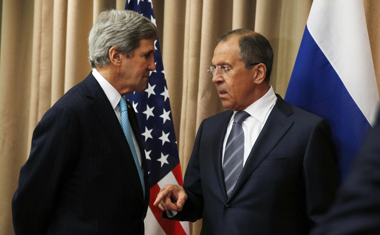 FILE - In this April 17, 2014, file photo, U.S. Secretary of State John Kerry, left, talks with Russian Foreign Minister Sergey Lavrov at the start of a bilateral meeting to discuss the ongoing situation in Ukraine in Geneva. Nearly a quarter century after the Cold War ended, the crisis in Ukraine symbolizes the weak foreign policy hand the United States often finds itself playing despite its status as the only global superpower. Kerry last week in Geneva negotiated a deal with Russia, Ukraine and the European Union that was designed to ease tensions. (AP Photo/Jim Bourg, Pool)