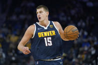 Denver Nuggets center Nikola Jokic dribbles aduring the first half of the team's preseason NBA basketball game against the Golden State Warriors in San Francisco, Wednesday, Oct. 6, 2021. (AP Photo/Jeff Chiu)