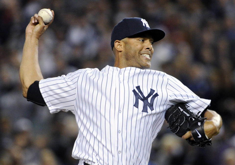 File- This Sept 26, 2013, file photo shows New York Yankees pitcher Mariano Rivera, delivers the ball to the Tampa Bay Rays during the eighth inning of a baseball game in New York. Rivera has become baseballs first unanimous Hall of Fame selection, elected along with Roy Halladay, Edgar Martinez and Mike Mussina. Rivera received all 425 votes in balloting by the Baseball Writers Association of America. The quartet will be enshrined in Cooperstown along with Todays Game Era Committee selections Harold Baines and Lee Smith on July 21. (AP Photo/Bill Kostroun, File)