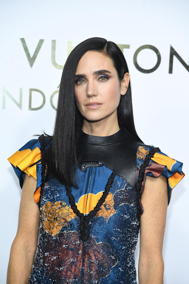 <p>Connelly attended the opening of the Louis Vuitton Boutique in Paris rocking bone-straight strands, bold brows and nude lips. Trés chic! (Photo: Getty Images) </p>