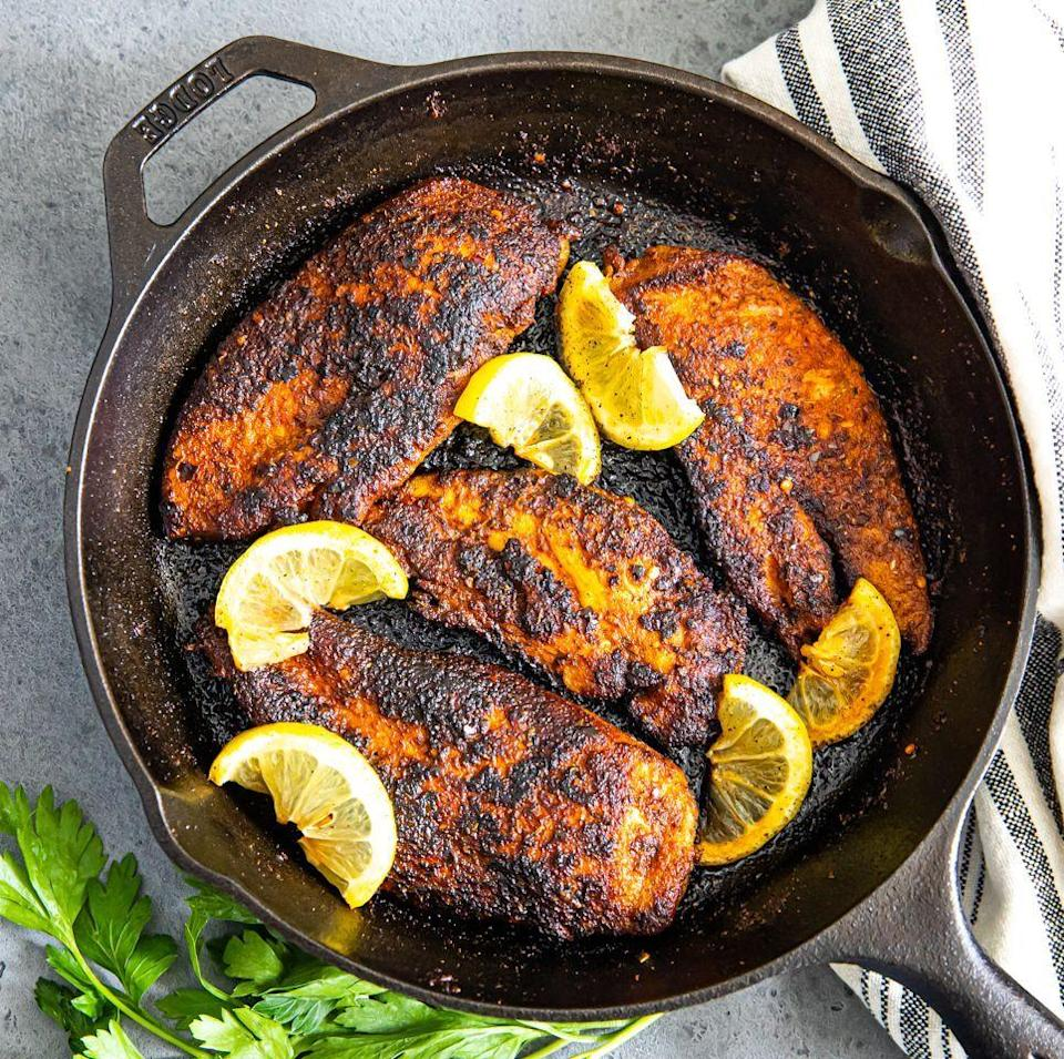 """<p>Featuring big, bold, and spicy Cajun flavours, this blackened chicken recipe is so delicious and super easy to make. It's called """"blackened"""" chicken because the heavily browned outer crust made possibly by preheated hot pan. Throwing the pan in the oven before cooking the chicken on the stovetop is key for the perfect char. Don't worry, your chicken will be perfectly juicy on the inside, too. </p><p>Get the <a href=""""https://www.delish.com/uk/cooking/recipes/a35027985/blackened-chicken-recipe/"""" rel=""""nofollow noopener"""" target=""""_blank"""" data-ylk=""""slk:Blackened Chicken"""" class=""""link rapid-noclick-resp"""">Blackened Chicken</a> recipe.</p>"""