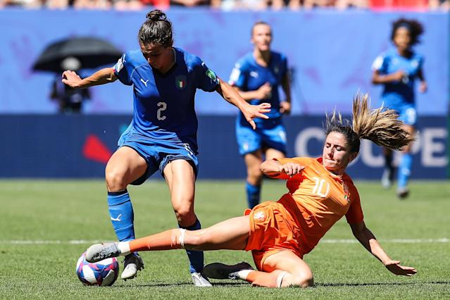 #2 Valentina Bergamaschi of Italy competes for the ball with #10 Danielle Van De Donk of Netherlands during the 2019 FIFA Women's World Cup France Quarter Final match between Italy and and Netherlands at Stade du Hainaut on June 29, 2019 in Valenciennes, France. (Photo by Zhizhao Wu/Getty Images)