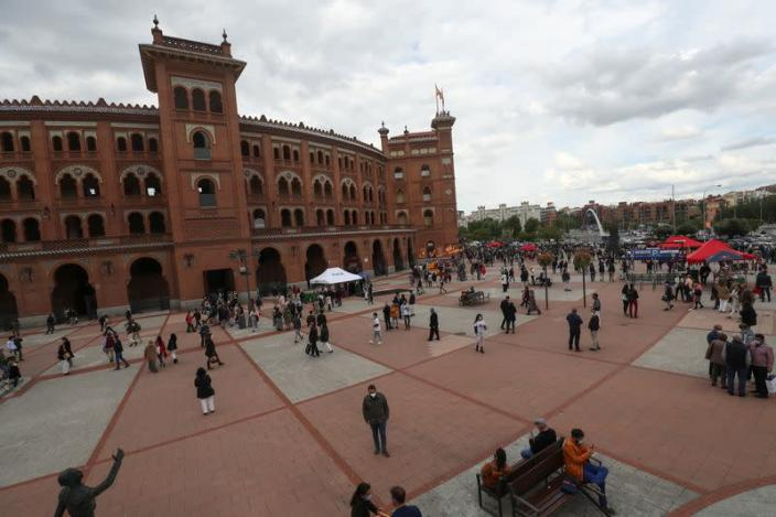 People stand outside Las Ventas bullring ahead of the first bullfight since the start of the COVID-19 pandemic, in Madrid