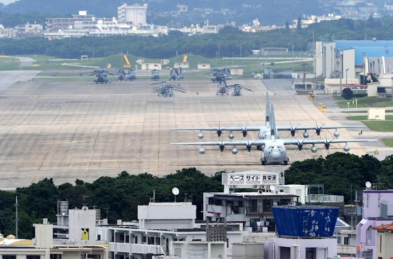 A proposal to relocate Futenma air base in Ginowan to the Henoko region of Okinawa, first mooted in 1996, has become the focus of anger among locals, who insist it should be shut and a replacement built elsewhere in Japan (AFP Photo/Toshifumi Kitamura)