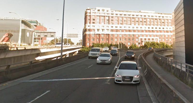 Pictured are cars merging on the Western Distributor at Pyrmont.