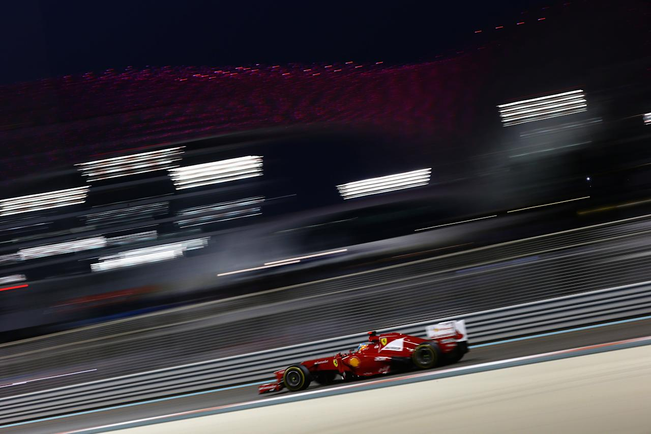 ABU DHABI, UNITED ARAB EMIRATES - NOVEMBER 04:  Fernando Alonso of Spain and Ferrari drives during the Abu Dhabi Formula One Grand Prix at the Yas Marina Circuit on November 4, 2012 in Abu Dhabi, United Arab Emirates.  (Photo by Paul Gilham/Getty Images)