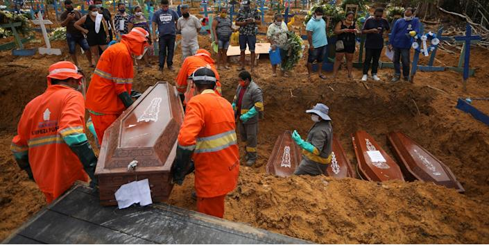 Gravediggers carry a coffin during a collective burial of people that have passed away due to the coronavirus disease (COVID 19), at the Parque Taruma cemetery in Manaus, Brazil April 28, 2020..JPG