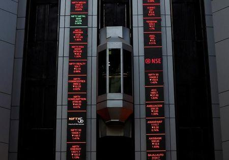 An elevator travels next to electronic boards displaying stock figures at the National Stock Exchange (NSE) building in Mumbai, February 9, 2018. REUTERS/Danish Siddiqui/Files