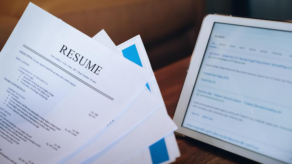 woman holding resume application with using tablet digital to job search on internet.