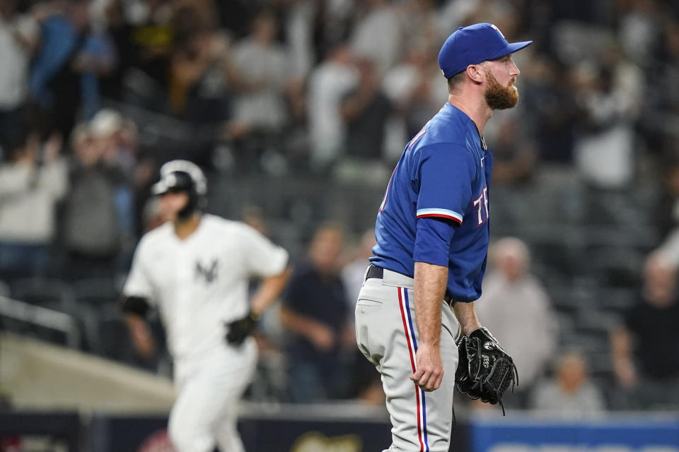 Texas Rangers relief pitcher Spencer Patton reacts as New York Yankees' Gary Sanchez runs the bases after hitting a two-run home run during the eighth inning of a baseball game Wednesday, Sept. 22, 2021, in New York. (AP Photo/Frank Franklin II)