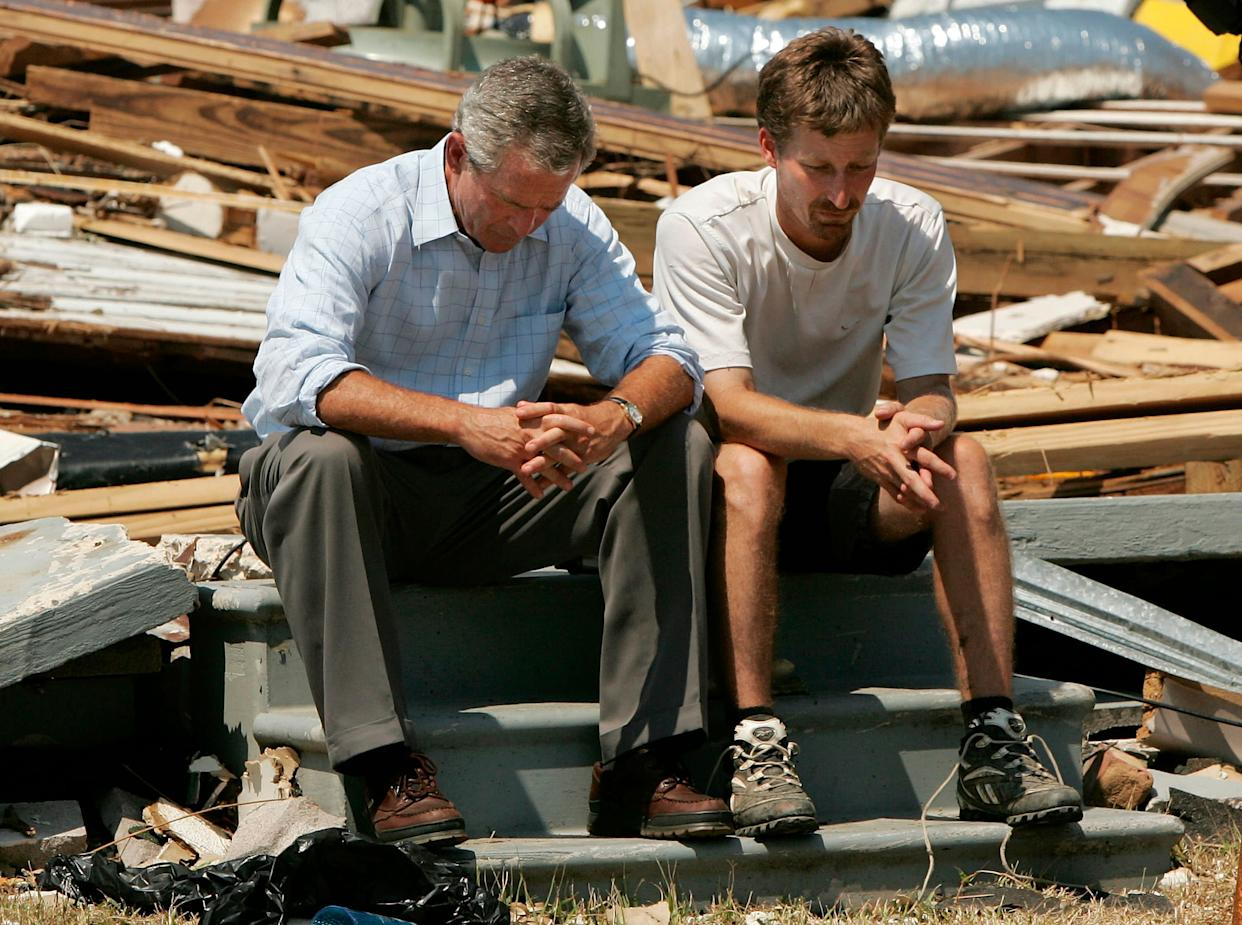 George Bush sitting with Biloxi resident Patrick Wright, whose home was destroyed during Hurricane Katrina in 2005. (Photo: Win McNamee via Getty Images)