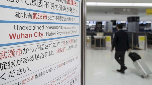 PHOTO: A passenger walks past a notice for passengers from Wuhan, China displayed near a quarantine station at Narita airport on Jan. 17, 2020, in Narita, Japan. (Tomohiro Ohsumi/Getty Images)