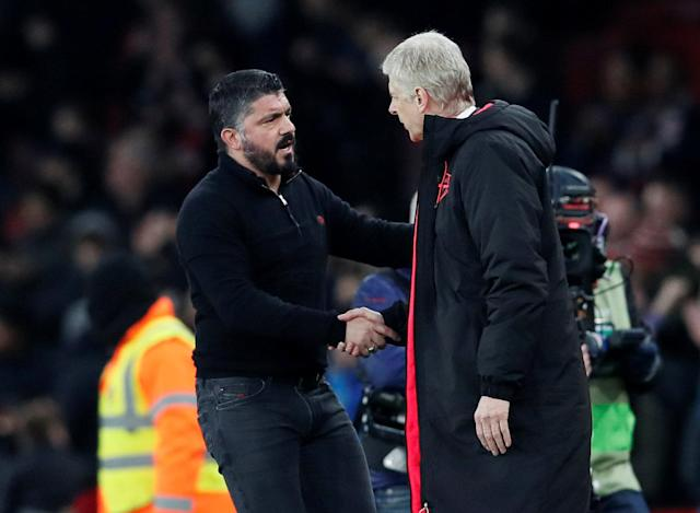 Soccer Football - Europa League Round of 16 Second Leg - Arsenal vs AC Milan - Emirates Stadium, London, Britain - March 15, 2018 Arsenal manager Arsene Wenger shakes hands with AC Milan coach Gennaro Gattuso after the match REUTERS/David Klein