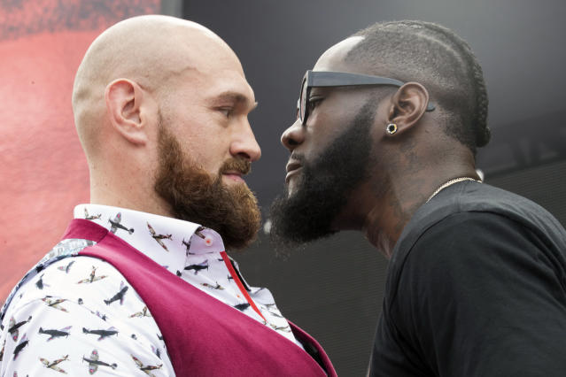 Tyson Fury, left, and Deontay Wilder face off, Tuesday, Oct. 2, 2018, during a news conference in New York ahead of their heavyweight world championship boxing match in Los Angeles on Dec. 1. (AP Photo/Mary Altaffer)