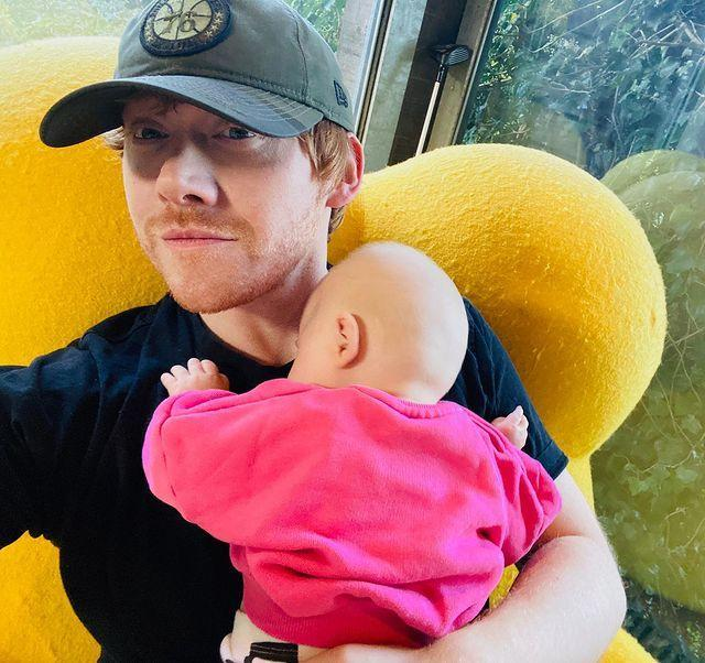 """<p>Ron Weasley himself joined Instagram this week (it's been ten years, Rupert!) and chose a spectacular picture for his inaugural post, introducing his baby daughter, Wednesday, to fans. </p><p>'Here I am. Grint on the Gram! Here to introduce you all to Wednesday G Grint. Stay safe,' he wrote.</p><p>Grint and his long-term girlfriend Georgia Groome (best known for her role as Georgia in Angus, Thongs And Perfect Snogging) welcomed their first child together in May 2020.</p><p>Fans were thrilled to see Grint on the 'gram, as were some of his fellow Harry Potter co-stars with Tom Felton (Malfoy) commenting: 'Welcome Weasley, it's about time. Love to Wednesday!' James Phelps, who played one half of the Weasley twins, Fred, was another to comment.</p><p>Oh, and Grint has made his Instagram profile picture him receiving a kiss on the cheek from Dame Maggie Smith, aka Professor McGonagall. All in all, a great effort from Rupert.</p><p><a href=""""https://www.instagram.com/p/CHaijlLHDei/"""" rel=""""nofollow noopener"""" target=""""_blank"""" data-ylk=""""slk:See the original post on Instagram"""" class=""""link rapid-noclick-resp"""">See the original post on Instagram</a></p>"""
