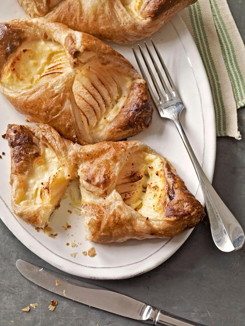 "<p>Straight from your grocer's freezer, the dough for this sweet-and-savory, apple-cheese danish rises to the occasion—no flour, food processor, or kneading required.</p><p><strong><a href=""https://www.countryliving.com/food-drinks/recipes/a3009/apple-cheese-danish-recipe/"" rel=""nofollow noopener"" target=""_blank"" data-ylk=""slk:Get the recipe"" class=""link rapid-noclick-resp"">Get the recipe</a>.</strong></p>"