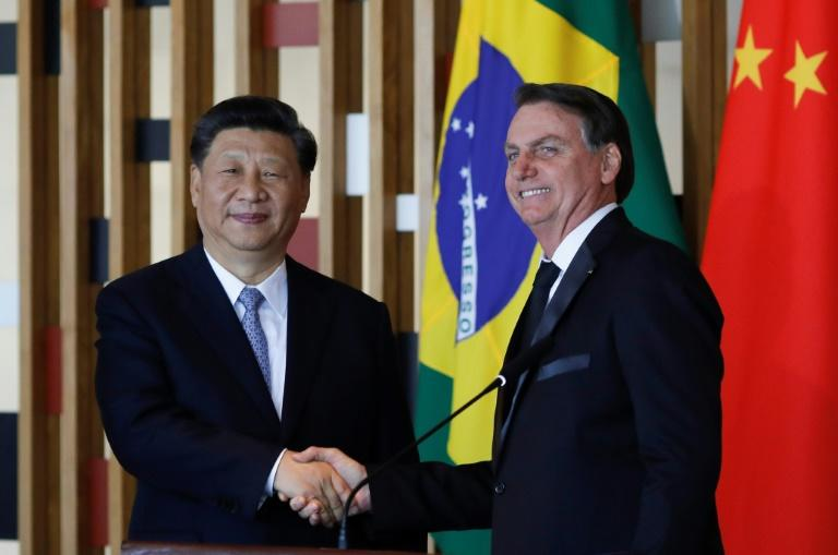 Chinese President Xi Jinping (L) and Brazilian President Jair Bolsonaro after their bilateral meeting in Brasilia on the eve of a BRICS summit