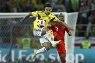 <p>Radamel Falcao vies for a ball with Ashley Young </p>