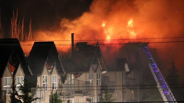 A fire at 31560 Delair Road in Abbotsford spread across the roof of the apartment building from one end to the other.