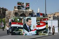 In the capital Damascus, Syrian President Bashar al-Assad's portraits line roads and inundate main squares, outnumbering those of his two little-known challengers