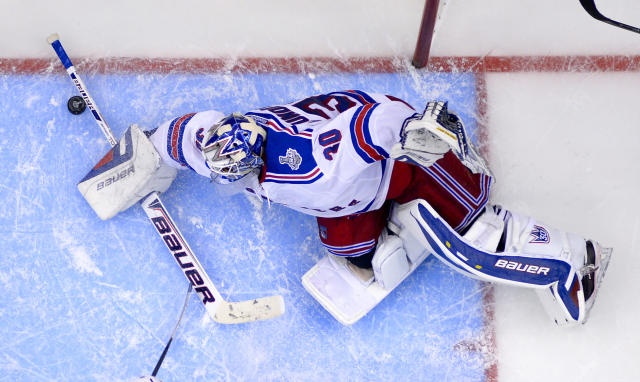 New York Rangers goalie Henrik Lundqvist, of Sweden, top, blocks a shot by the Los Angeles Kings during the third period in Game 1 of the NHL hockey Stanley Cup Finals, Wednesday, June 4, 2014, in Los Angeles. (AP Photo/Mark J. Terrill)