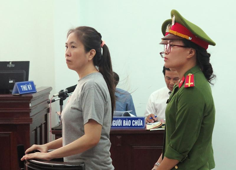 "Vietnamese blogger Nguyen Ngoc Nhu Quynh (L), also known as ""Mother Mushroom"", stands trial at a courthouse in the central city of Nha Trang on June 29"