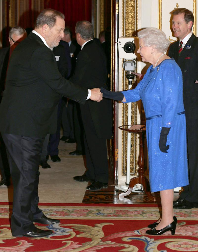 Queen Elizabeth II meets Weinstein during the Dramatic Arts reception at Buckingham Palace on Feb. 17, 2014 in London. (Photo: WPA Pool via Getty Images)