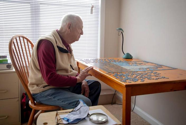 Albert Robinson works on a puzzle in his apartment, on Tuesday, Mar. 2, 2021, in Raleigh, N.C.