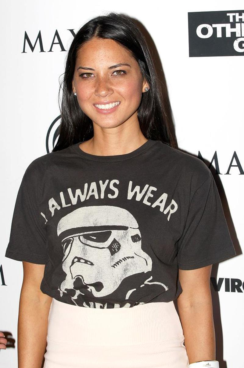 """<p>No wonder Munn's been called """"Hollywood's hottest geek."""" The former <em>Newsroom</em> star was also snapped in a Darth Vader shirt at a movie premiere during Comic-Con in San Diego. (Photo: Getty Images) </p>"""