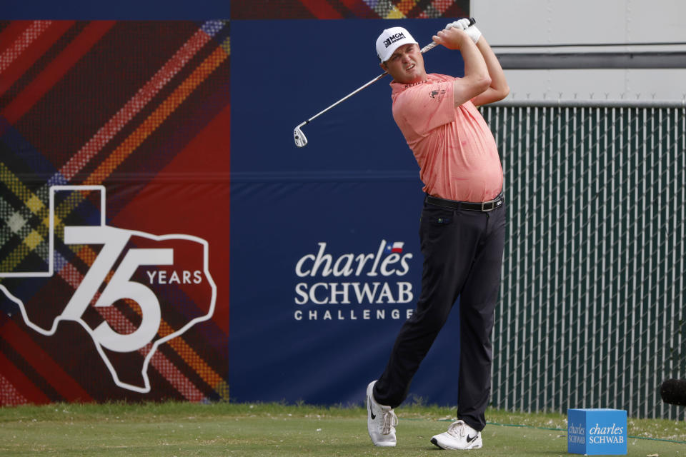 Jason Kokrak watches his shot from the 16th tee during the final round of the Charles Schwab Challenge golf tournament at the Colonial Country Club in Fort Worth, Texas Sunday, May 30, 2021. (AP Photo/Michael Ainsworth)