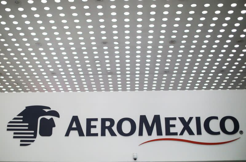 FILE PHOTO: The logo of the aerial company Aeromexico is seen at the Aeromexico counter at Benito Juarez international airport in Mexico City