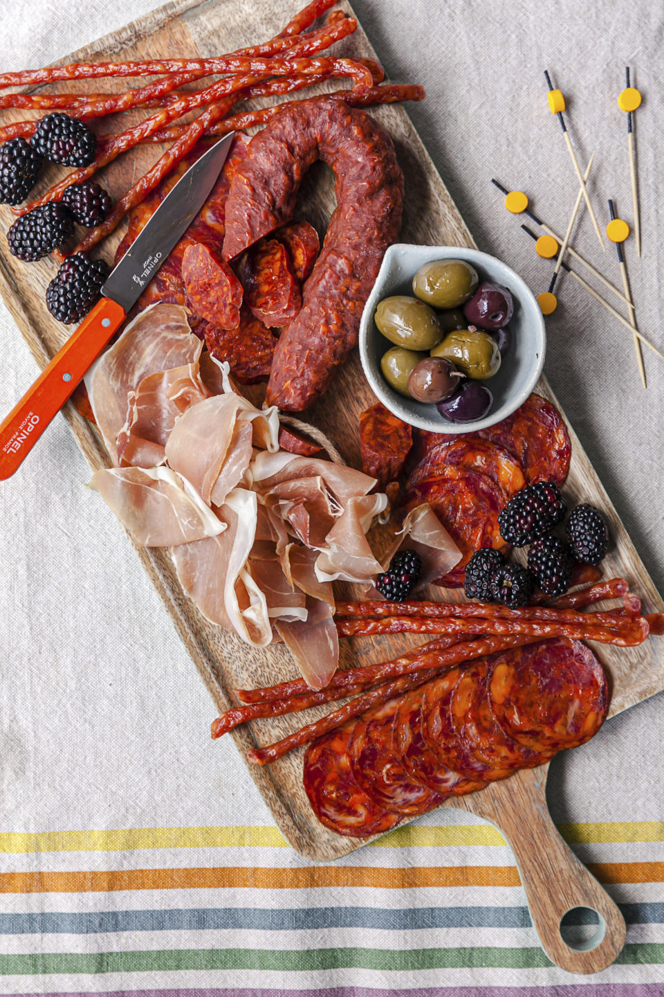 A variety of salumis and olives are displayed on a graze board in New York. Salumi was born out of necessary to preserve meat pre-refrigeration, and to use all parts of the pig with no waste. Now there are many manufacturers commercially producing packaged salumi, available at supermarkets. (Carrie Crow via AP)