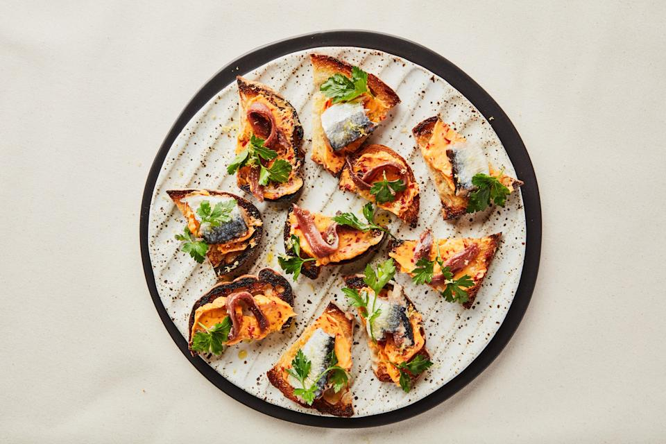 """<a href=""""https://www.bonappetit.com/recipe/anchovy-and-sardine-toasts-with-chile-butter?mbid=synd_yahoo_rss"""" rel=""""nofollow noopener"""" target=""""_blank"""" data-ylk=""""slk:See recipe."""" class=""""link rapid-noclick-resp"""">See recipe.</a>"""