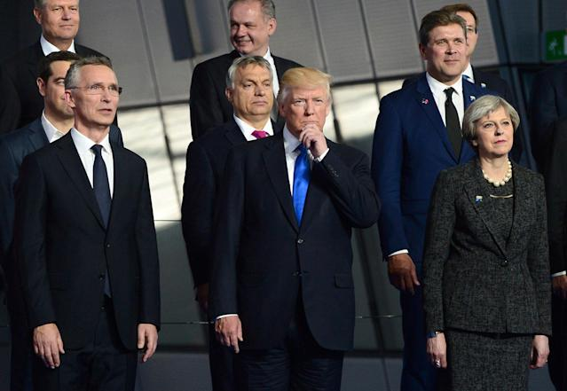 <p>President Donald Trump, center, center, flanked by British Prime Minister Theresa May, right, and NATO Secretary General Jens Stoltenberg, joins fellow leaders in a group photo at NATO headquarters during the NATO Summit in Brussels, Belgium on Thursday, May 25, 2017. (Sean Kilpatrick/The Canadian Press via AP) </p>