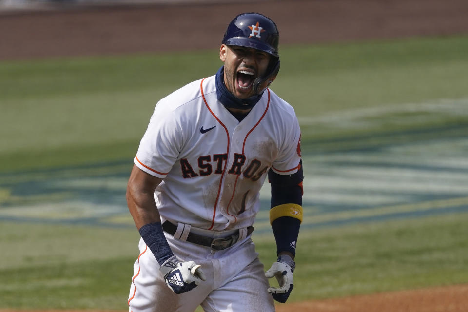 Houston Astros' Carlos Correa celebrates after hitting a three-run home run against the Oakland Athletics during the fourth inning of Game 4 of a baseball American League Division Series in Los Angeles, Thursday, Oct. 8, 2020. (AP Photo/Ashley Landis)