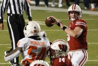 Wisconsin quarterback Graham Mertze throws a pass during the first half of an NCAA college football game against Illinois Friday, Oct. 23, 2020, in Madison, Wis. (AP Photo/Morry Gash)