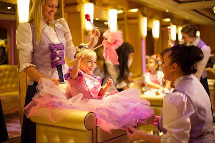 When young princesses-to-be make their royal entrance at the Bibbidi Bobbidi Boutique, they are greeted by their very own Fairy Godmother-in-training who transforms them with magical makeovers.
