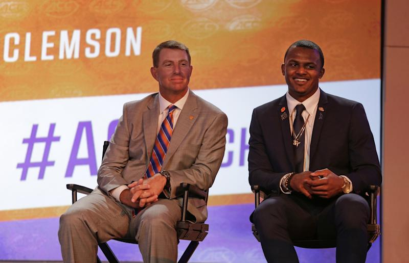 Clemson head coach Dabo Swinney, left, and Deshaun Watson, right, smiles as they listen to a question during a news conference at the Atlantic Coast Conference Football Kickoff in Charlotte, N.C., Friday, July 22, 2016. (AP Photo/Chuck Burton)