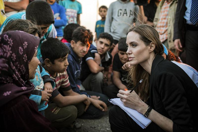 FILE - This June 18, 2013 photo released by the United Nations High Commissioner for Refugees (UNHCR) shows special envoy Angelina Jolie taking notes as she speaks with Syrian refugees in a Jordanian military camp based near the Syria-Jordan border. The Board of Governors of the Academy of Motion Picture Arts and Sciences will present Honorary Awards to Angela Lansbury, Steve Martin and Piero Tosi, and the Jean Hersholt Humanitarian Award to Jolie. All four awards will be presented at the Academy's 5th Annual Governors Awards on Saturday, November 16, 2013, at the Ray Dolby Ballroom at the Hollywood & Highland Center in the Hollywood section of Los Angeles. (AP Photo/United Nations High Commissioner for Refugees , O. Laban-Matte, File)