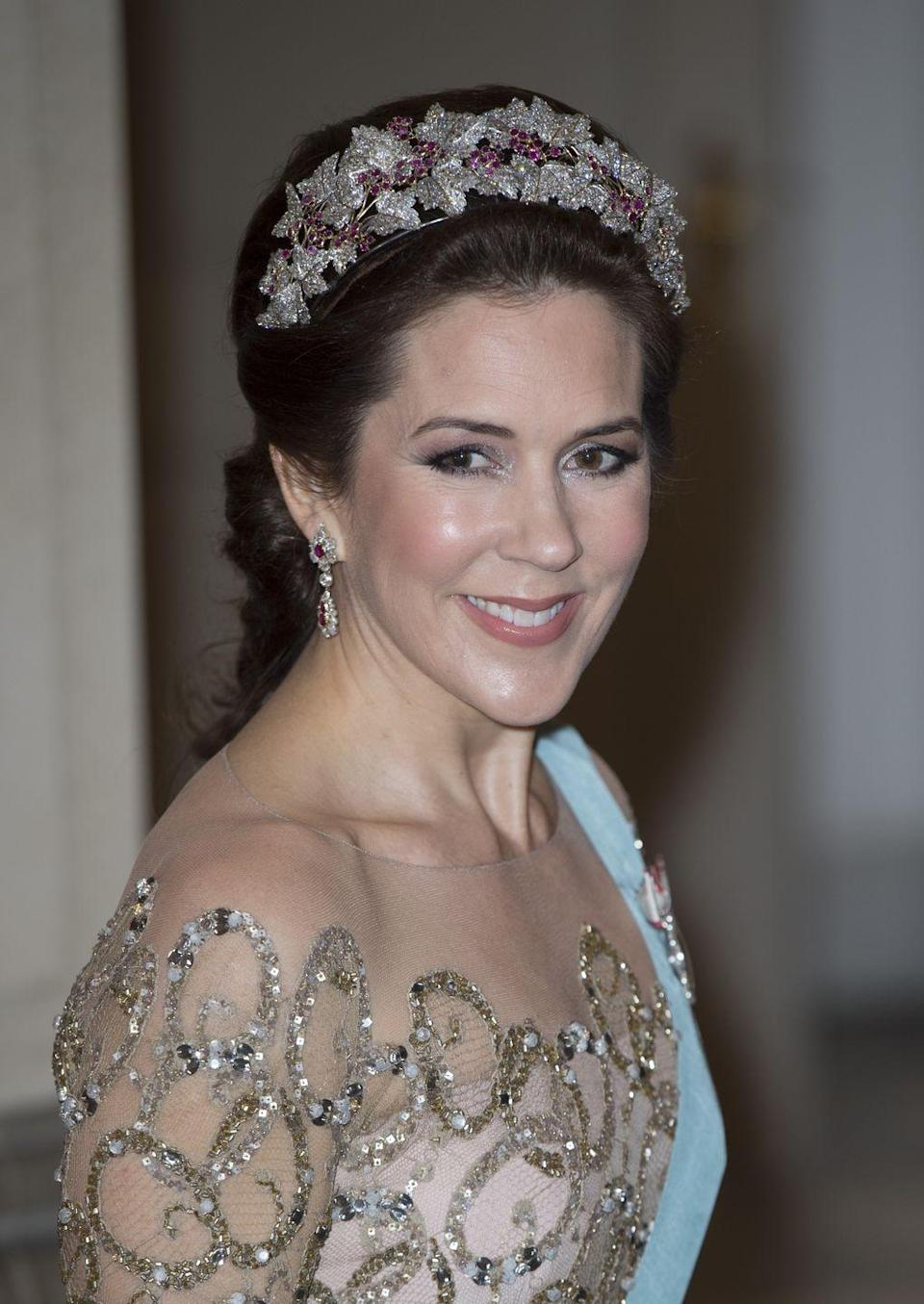 """<p>Nothing says """"princess"""" like a ruby-and-diamond-encrusted tiara, especially one that dates back two centuries. According to royal gem-watching blog, <a href=""""http://www.thecourtjeweller.com/2016/08/the-danish-ruby-parure-tiara.html"""" rel=""""nofollow noopener"""" target=""""_blank"""" data-ylk=""""slk:The Court Jeweller"""" class=""""link rapid-noclick-resp"""">The Court Jeweller</a>, the gems were first worn by a royal lady close to Napoleon. The jewels made several passes through a few different countries via royal weddings, eventually ending up in Denmark. Wearing the tiara is a nod to the long tradition that connects generations of European royalty. </p>"""